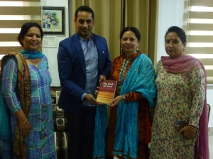 Jasvinder presenting the book